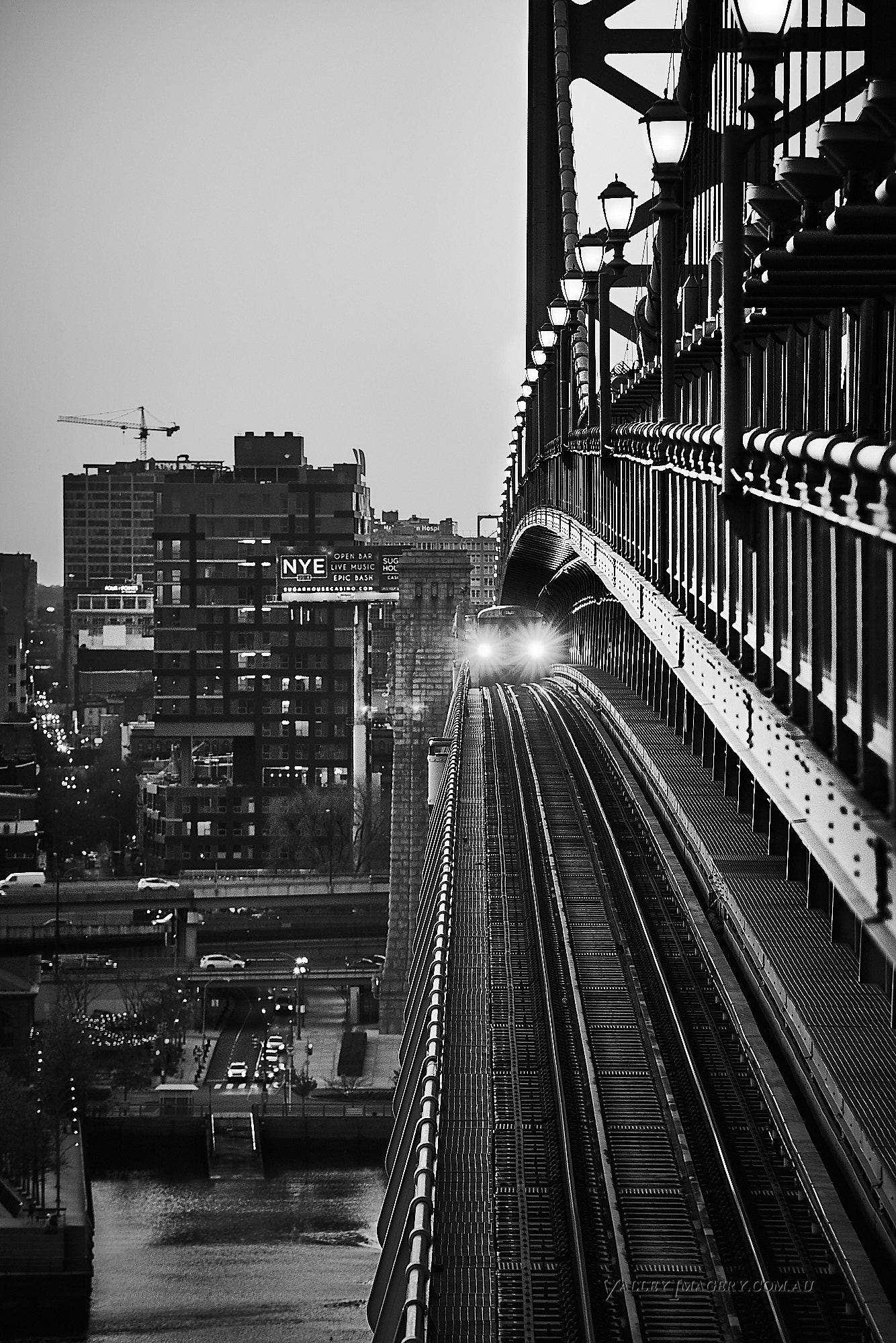 Commuter train Philidelphia Benjamin Franklin bridge.